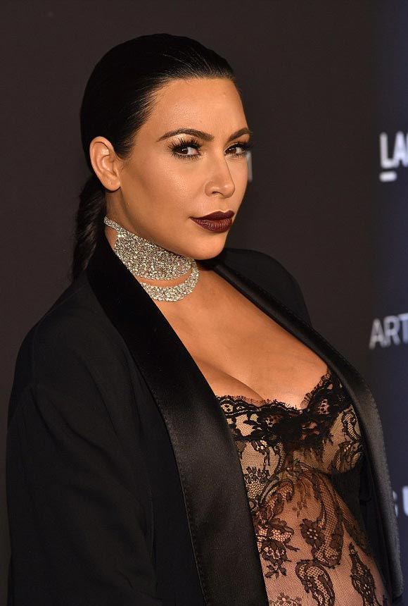 Kim-Kardashian-bump-see-through-jumpsuit-LACMA-2015-05